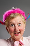 Silly face with pink tiara Royalty Free Stock Images