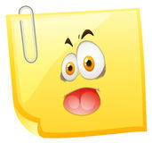 Silly face on yellow paper Royalty Free Stock Images