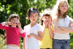 Silly faces. Four little girlfriends playing making silly faces. Shallow depth of field Royalty Free Stock Images