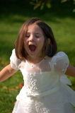 Silly Flower Girl. Four year old flower girl making silly faces stock images