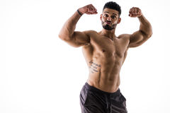 Silly, funny bodybuilder doing biceps pose Royalty Free Stock Photography