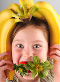 Silly girl with fruit Stock Image