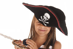 Silly girl in Halloween pirates hat holding swoad Royalty Free Stock Photo