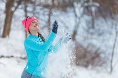 Silly girl playing with snow Royalty Free Stock Images