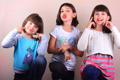 Silly Girls. Three little elementary school aged girls having fun making silly faces Stock Photography