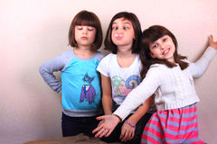 Silly Girls Playtime. Three little elementary school aged girls having fun making silly faces Royalty Free Stock Photography