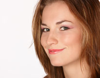 Silly grin. Brunette with silly grin and pink makeup royalty free stock photos