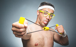 Silly guy doing aerobics royalty free stock photography