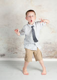 Silly hyper boy. Fun boy being silly and hyper.  Dressed in his Easter clothes with a tie Stock Photography
