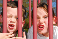 Silly kids on playground Royalty Free Stock Images