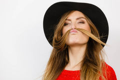 Silly lady playing with hairs. Royalty Free Stock Images