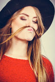 Silly lady playing with hairs. Stock Photography