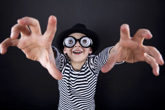 Silly little boy in black hat Royalty Free Stock Photos