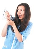 Silly looking amazed woman with phonendoscope Stock Photography