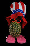 Silly looking pineapple. With red, white and blue hat Stock Images