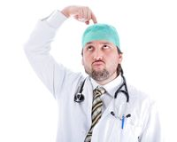 Silly male doctor in characteristic clothes Royalty Free Stock Photos