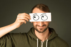 Silly man looking with hand drawn eye balls. On paper royalty free stock photography