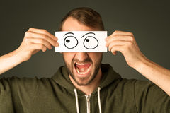 Silly man looking with hand drawn eye balls royalty free stock photo