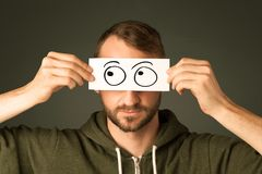 Silly man looking with hand drawn eye balls stock photos