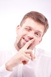 Silly man picking his nose Stock Image