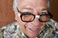 Silly Man with Taped Glasses Royalty Free Stock Photo