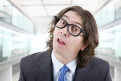 Silly man. Young silly business man at the office Stock Photo