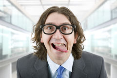 Silly man. Young silly businessman portrait at the office Stock Photo