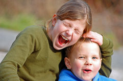Silly Moment of Siblings Stock Photos