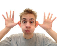 Silly Monkey Face. A young adult man makes a silly monkey face over a pure white background Royalty Free Stock Photos