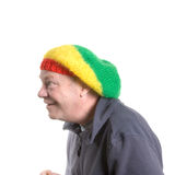 Silly old Man. Wearing rasta bonnet clowning around royalty free stock photography