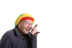 Silly old Man. Wearing rasta bonnet clowning around stock photo
