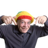 Silly old Man. Wearing rasta bonnet clowning around royalty free stock photo