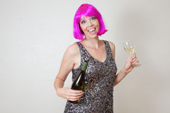 Silly party woman with wine and pink hair Stock Photo