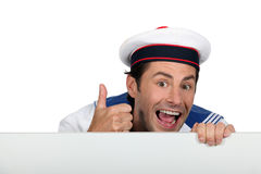Silly sailor with a board Stock Image