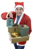 Silly santa. Young man with santa hat holding some gifts, isolated Royalty Free Stock Images
