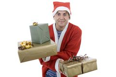 Silly santa. Young man with santa hat holding some gifts, isolated Royalty Free Stock Image