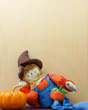 Silly Scarecrow Leaning Against Pumpkin Royalty Free Stock Image