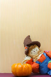 Silly Scarecrow Leaning Against Pumpkin Royalty Free Stock Photos