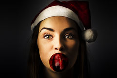 Silly season santa girl with christmas decoration Royalty Free Stock Photos