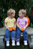 Silly Sisters. Two little girls stick out their tongues at each other Royalty Free Stock Photos