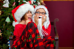 Silly Sisters Playing Santa Stock Image