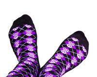 Silly socks with skulls. Fun purple and black socks with skulls on  white background Stock Photography