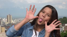 Silly Teen Girl Making Funny Faces Stock Image