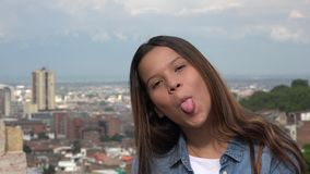 Silly Teen Girl Making Funny Faces Stock Photo