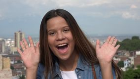 Silly Teen Girl Making Funny Faces. A young teen hispanic girl Stock Photography
