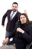 Silly. Two silly young business men portrait isolated on white background Stock Images