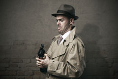 Silly vintage detective with a gun Stock Photos