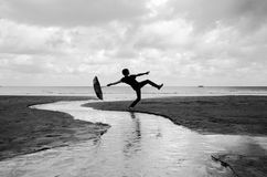 Silly walks on a wet beach Royalty Free Stock Images