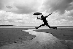 Silly walks on a wet beach. Sardinero beach in Santander on an overcast day stock image