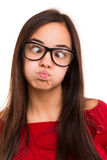 Silly woman. A beautiful young asian woman making a silly expression, isolated over white Stock Image